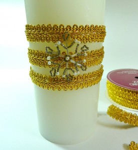 Candle with gold trim and embellishment