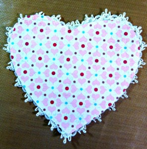 Paper hearts glue together.