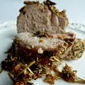 Slices of garlic rosemary crusted pork tendorloin