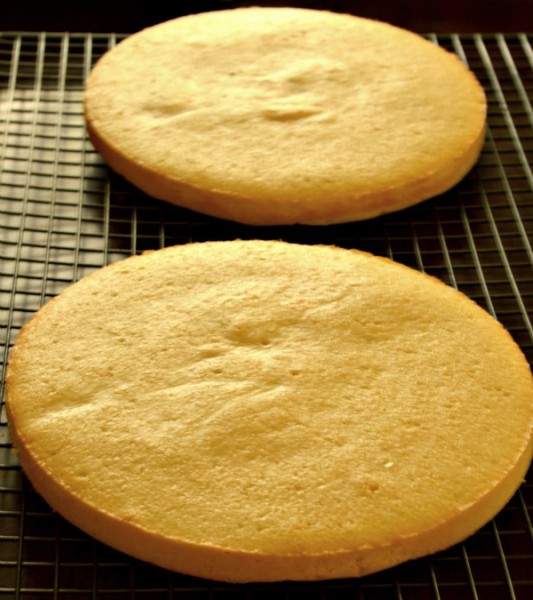Sponge cakes cooling on wire racks