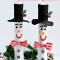Wrapping Paper Roll Snowman Candles - a lot of charming, holiday impact for little $$. SO cute!
