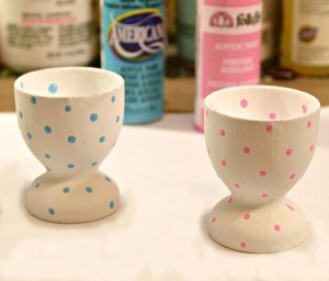 Inexpensive plastic eggs and wooden egg cups get prettied up for Easter! DIY Sequined & Flowered Egg in Painted Egg Cups at littlemisscelebration.com.