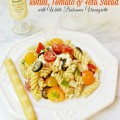 Rotini, Tomato & Feta salad, finished with a white balsamic vinaigrette & fresh Italian parsley, is a perfect summer salad! At littlemisscelebration.com