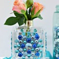 Don't toss that empty perfume bottle! With some gems & glue, upcycle it into a pretty bud vase that double as a decorative piece, too! At littlemisscelebration.com