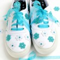 Ready-made flowers, fabric glue & ribbon laces make easy, prettied-up sneakers! At littlemisscelebration.com