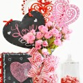 Painted laser cut hearts and pretty silk roses create a fast, Everlasting Valentine's Bouquet that brighten your home until spring! at littlemisscelebration.com