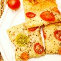 Cheese & Tomato Caesar Squares are a fast and oh-so-simple meal or snack for the cheese and pizza lovers! A buttery crust of crescent rolls is topped with gooey mozzarella cheese, parmesan and colorful cherry tomato slices, all sauced up with Caesar salad dressing! Recipe at littlemisscelebration