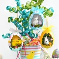 Hollow paper mache eggs become sweet Spring Scene Eggs that will have everyone peeking inside! Make a quick, sparkly tree, too! At littlemisscelebration.com