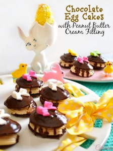 Chocolate Egg Cakes are bunny approved! Inspired from a favorite Easter Egg, chocolate egg cakes sandwich peanut cream filling and are drenched in milk chocolate glaze with a candy bow on top! Recipe at littlemisscelebration.com