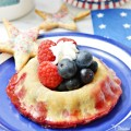 Double Decker Berry Pie Bowls combine fresh blueberries and raspberries; one deck is baked in pie crust with the top deck bowl holding fresh berries and a star of whipped cream! at littlemisscelebration.com