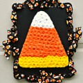 Make a fun, dimensional tribute to the white, orange and yellow candy of the season with a Felt Flower Candy Corn Plaque! Easy & fun to make! at littlemisscelebration.com