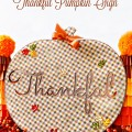 Welcome Thanksgiving guests – or gift your holiday hostess – with this Plaid & Sparkle Thankful Pumpkin Sign! at littlemisscelebration.com