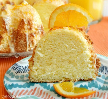 Perfect for a celebration or to brighten a dark day, Glazed Orange Sponge Cake is light-as-air & delicious! Recipe at littlemisscelebration.com