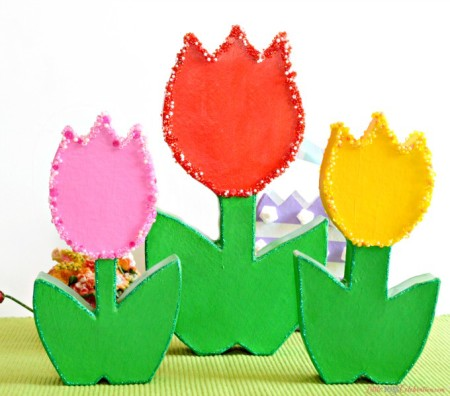 How CUTE are these forever tulips? It's easy to turn paper mache flowers into bright, sparkling charmers perfect for Mother's Day! at littlemisscelebration.com