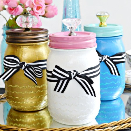 Make Mom an easy, glamorous gift! SO pretty Paint & Sparkle Mason Vanity Jars are a pretty place to stash beauty supplies or treasures! From littlemisscelebration.com for PinkWhen