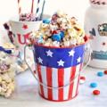 Make a batch of sweet-n-salty patriotic popcorn for your July 4th celebration! With crunch and texture, chocolate and vanilla, everyone will be eating this easy treat by the handful. Makes a great favor, too! At littlemisscelebration.com