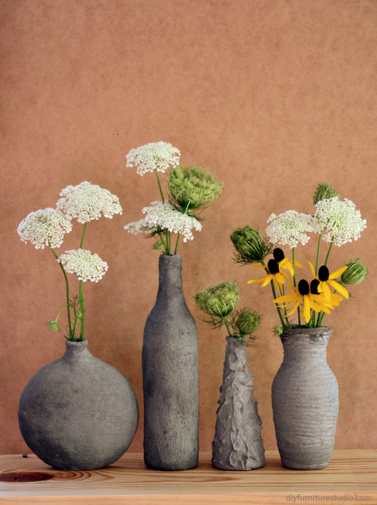 Hand-Formed Cement Over Glass Vases from DIY Furniture Studio