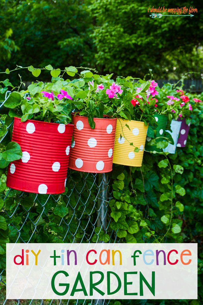 DIY Tin Can Fence Garden from i should be mopping the floor